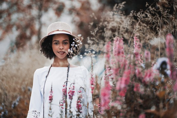 Black girl in hat outdoors