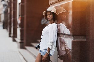 Black girl in hat on the street