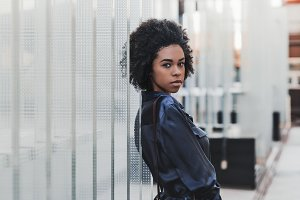 Black girl outdoors, glass blocks