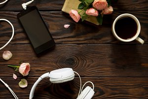 Smartphone, headphones, coffee cup o