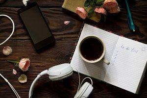 Smartphone, headphones, coffee cup o
