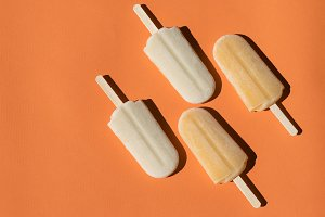 Popsicles on an orange background
