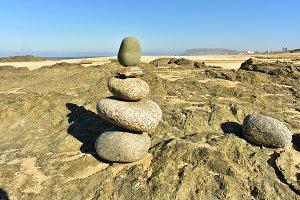 Zen rock stack on seashore