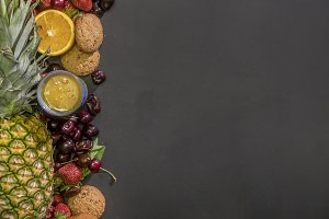 close up bunch of sweet low diet fresh food for breakfast concept with copy space on dark surface