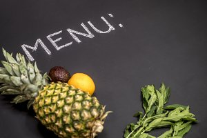 close up menu copy space concept with fresh pineapple mint avocado and orange mockup