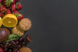 mockup with fresh raw fruits and avocado with biscuits copy space text on blackboard