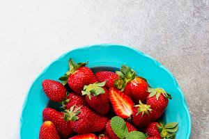 fresh strawberries on stone backgro