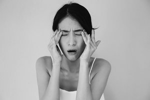 Young Asian woman having eye pain and soreness in black and white tone - Healthcare and Medical concept