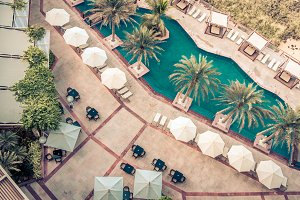 Hotel Poolside with Parasols and