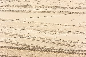 Traces of cars on the sand