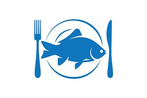 Fish on plate with fork and knife