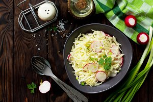 Salad with fresh cabbage and radish.