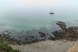 foggy day on the coast with green grass on the rocks Crozon, France 29 May 2018