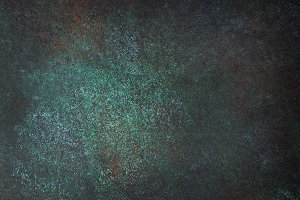 Dark texture slate background.