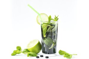 healthy mojito with activated charcoal. Detoxification and freshness. on a light background.