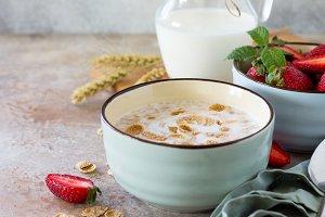 Grain flakes, milk, strawberries.