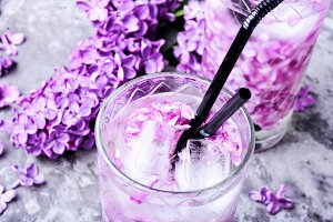 Refreshing drink with lilac and ice