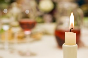 Candle on the festive table