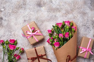 Pink roses bouquet  and gift boxes
