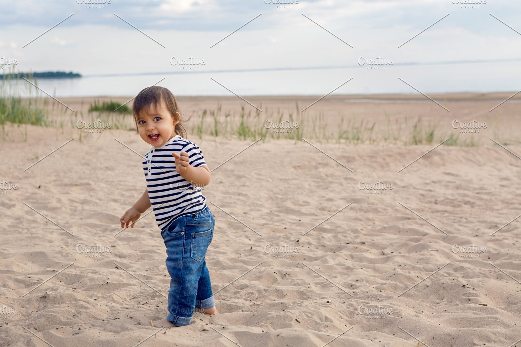 765aabd23 barefoot child walks on a sandy beach in a t-shirt ~ People Photos ...