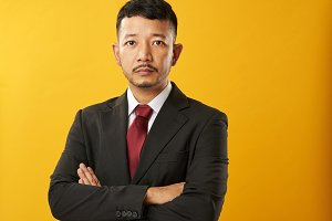 Asian businessman with crossed arms