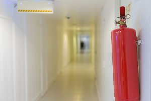 Fire extinguisher in front of room