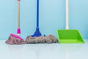 cleaning floor with wet mop