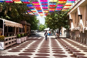 Street decorated with colored umbrellas and cafe in the city of Kropivnitsky, Ukraine