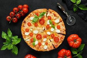 Homemade italian pizza on black