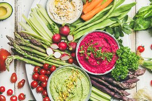 Healthy raw summer vegan snack plate over white table background