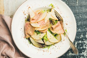 Summer salad with smoked turkey ham and pear, top view
