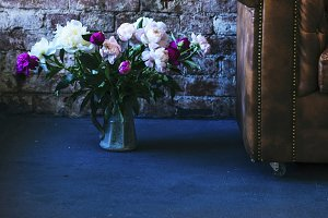Loft interior and bunch of peonies
