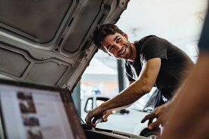 Car mechanics working at auto repair