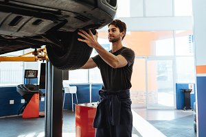 Professional car mechanic working