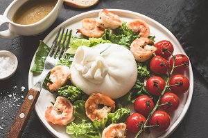 Tasty salad with burrata cheese