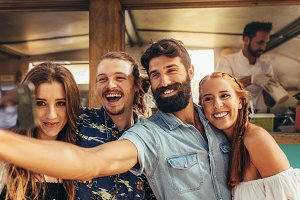Friends taking selfie at summer fest