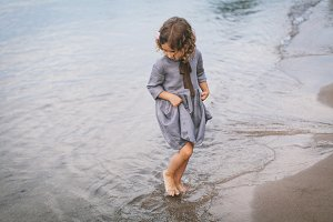 Little girl dancing in the water
