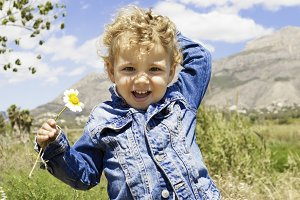 child with flower in the field