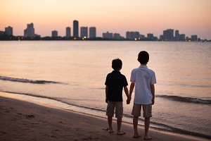 Two brothers watching sunset