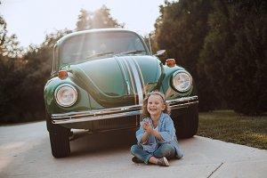 Girl sitting near old fashion car