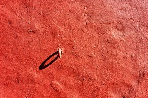 Ring in the red wall