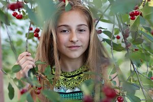 Portrait of a girl in a ripe cherry