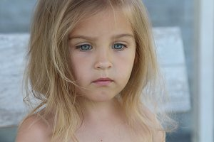 Pensive child with blue eyes