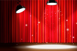 Red curtain with bright spotlight