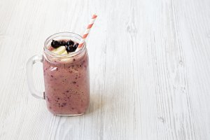 Smoothie on a white wooden surface