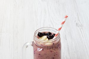 Side view, glass jar with smoothie