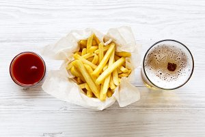 French fries with sauce and beer
