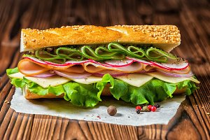 cutting baguette with sesame, ham