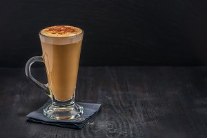 coffee latte in glass with froth