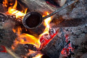 Cezve on the burning bonfire